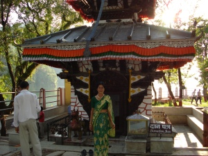 Balkumari Ghimire infront of the hindu stupa on the few lake island
